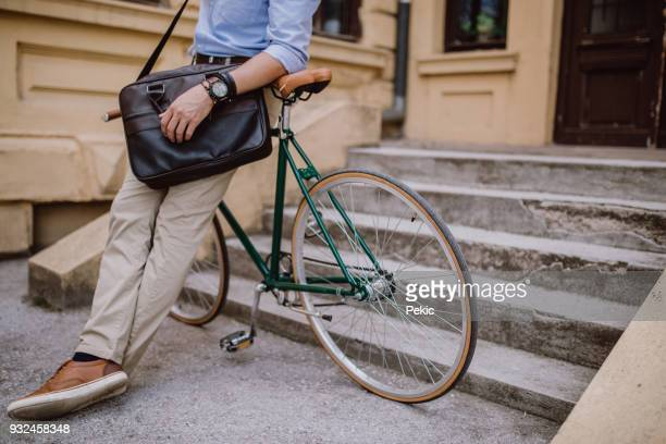 off to work on a bike - shoulder bag stock pictures, royalty-free photos & images