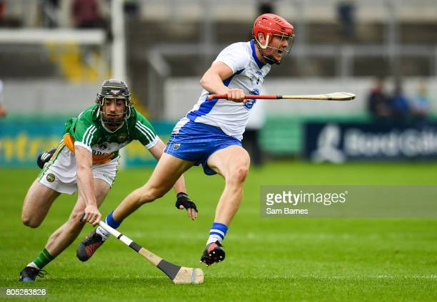 Offaly Ireland 1 July 2017 Tadhg de Burca of Waterford in action against Ben Conneely of Offaly during the GAA Hurling AllIreland Senior Championship...