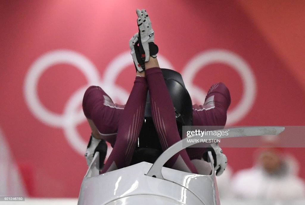 TOPSHOT - offbeatRussia's Nadezhda Sergeeva (front) and Russia's Anastasia Kocherzhova compete in the women's bobsleigh heat 1 run during the Pyeongchang 2018 Winter Olympic Games, at the Olympic Sliding Centre on February 20, 2018 in Pyeongchang. / AFP PHOTO / Mark Ralston