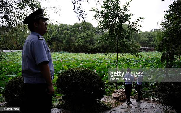 Offduty police officers enjoy the tranquility of Beijing's Black Bamboo Park one of the designated protest areas that will likely remain calm...
