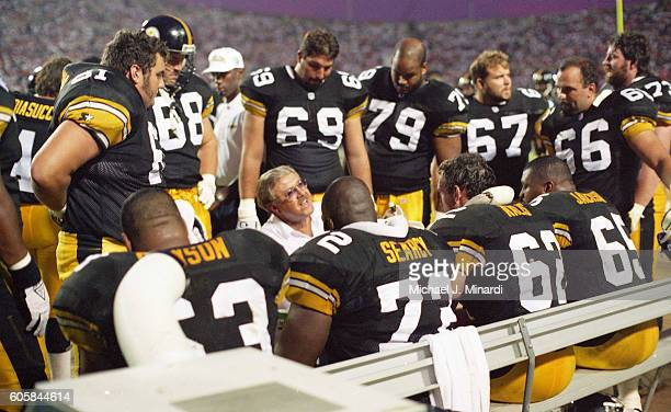 Offense Coach of the Pittsburgh Steelers talks to Offensive linemen prior to the game against the Tampa Bay Buccaneers at Tampa Stadium on August 19...