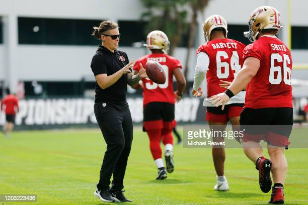 Offensive assistant coach Katie Sowers of the San Francisco 49ers runs a drill during practice for Super Bowl LIV at the Greentree Practice Fields on...