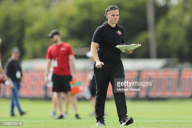 Offensive assistant coach Katie Sowers of the San Francisco 49ers looks on during practice for Super Bowl LIV at the Greentree Practice Fields on the...