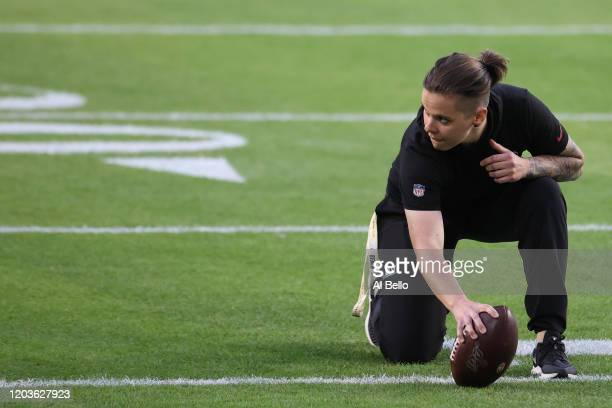 Offensive assistant coach Katie Sowers of the San Francisco 49ers looks on during warmups prior to Super Bowl LIV against the Kansas City Chiefs at...
