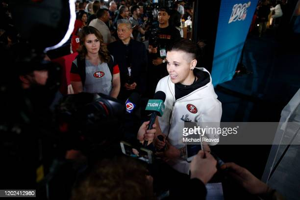 Offensive assistant coach Katie Sowers of the San Francisco 49ers speaks to the media during Super Bowl Opening Night presented by BOLT24 at Marlins...