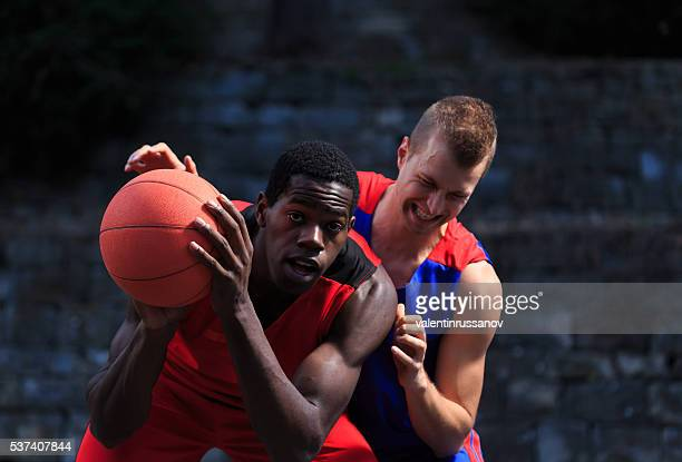 offensive basketball game - foul sports stock pictures, royalty-free photos & images