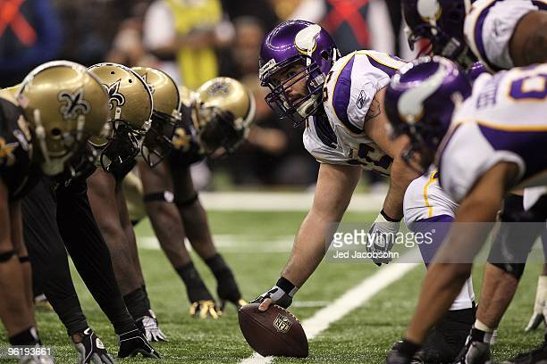 Offensive center John Sullivan of the Minnesota Vikings looks down the line of scrimmage as he gets set to snap the ball against the New Orleans...