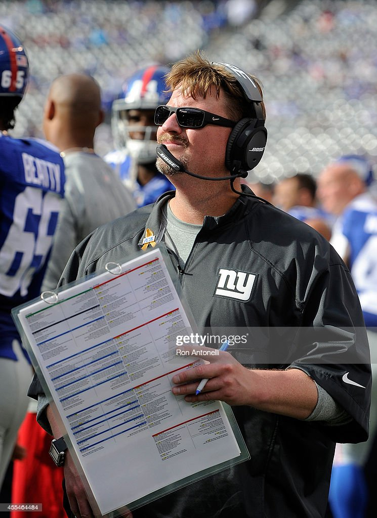 Offensive coordinator Ben McAdoo of the New York Giants looks on from the sideline against the Arizona Cardinals during a game at MetLife Stadium on September 14, 2014 in East Rutherford, New Jersey.