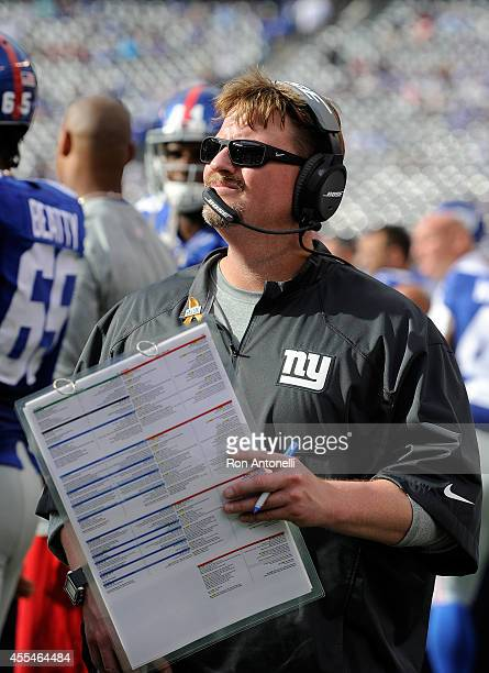 Offensive coordinator Ben McAdoo of the New York Giants looks on from the sideline against the Arizona Cardinals during a game at MetLife Stadium on...
