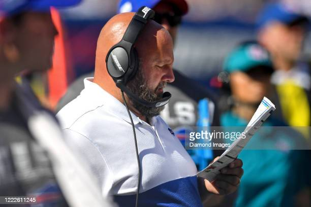 Offensive coordinator Brian Daboll of the Buffalo Bills reads his play sheet in the third quarter of a game against the New York Giants on September...
