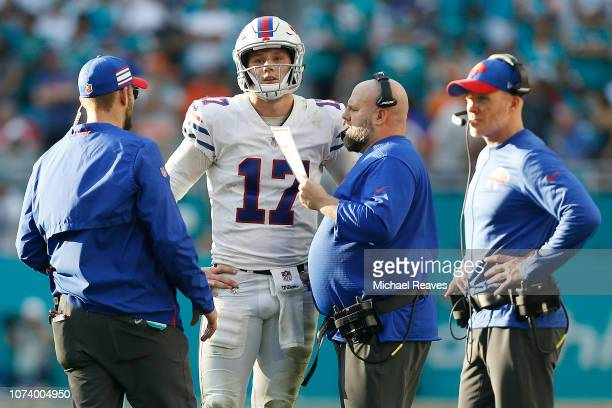 Offensive coordinator Brian Daboll of the Buffalo Bills talks with Josh Allen against the Miami Dolphins at Hard Rock Stadium on December 2, 2018 in...