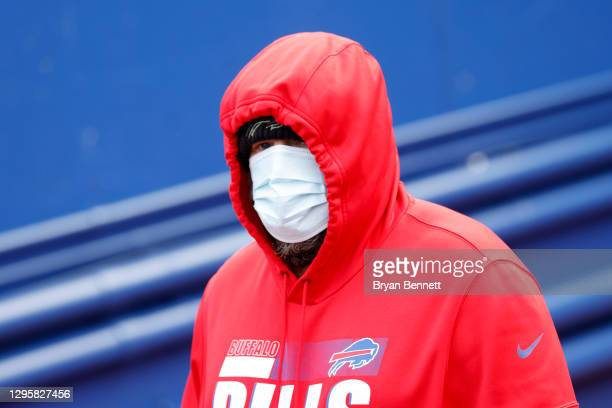 Offensive coordinator Brian Daboll of the Buffalo Bills walks to the field prior to an AFC Wild Card playoff game against the Indianapolis Colts at...