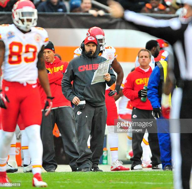 Offensive Coordinator Brian Daboll of the Kansas City Chiefs stands not he sideline during a game against the Cleveland Browns at Cleveland Browns...