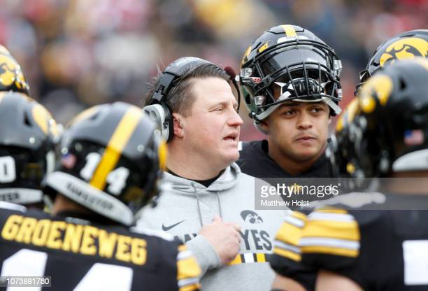 Offensive coordinator Brian Ferentz of the Iowa Hawkeyes talks with players during a break in the action in the first half against the Nebraska...