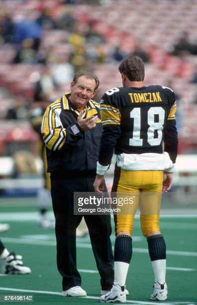 Offensive coordinator Chan Gailey of the Pittsburgh Steelers talks to quarterback Mike Tomczak before a game against the Jacksonville Jaguars at...