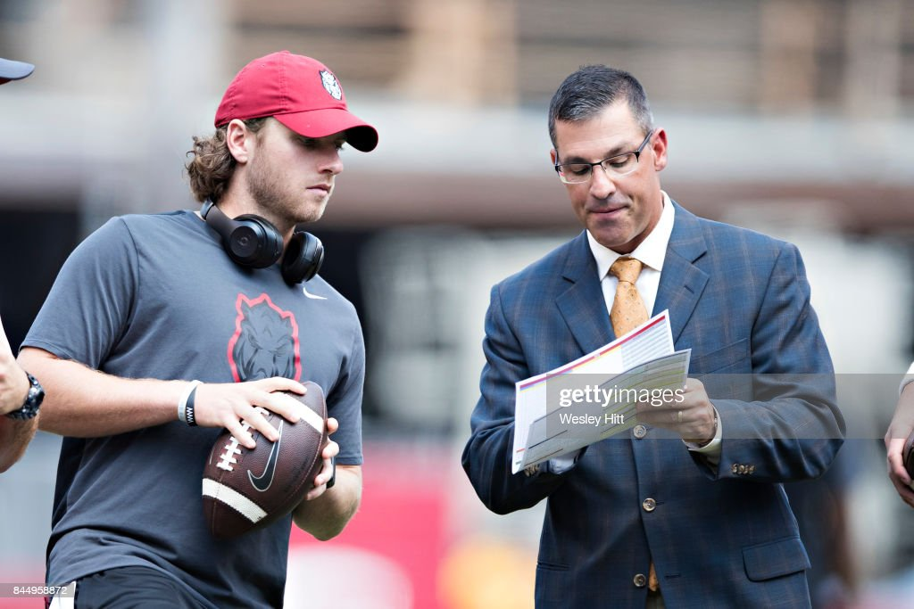 Offensive Coordinator Dan Enos talks on the field before a game with Austin Allen #8 of the Arkansas Razorbacks before a game against the TCU Horned Frogs at Donald W. Reynolds Razorback Stadium on September 9, 2017 in Fayetteville, Arkansas.