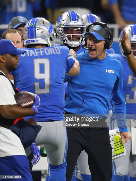 Offensive coordinator Darrell Bevell of the Detroit Lions celebrates a game clinching first down with Matthew Stafford while playing the Los Angeles...