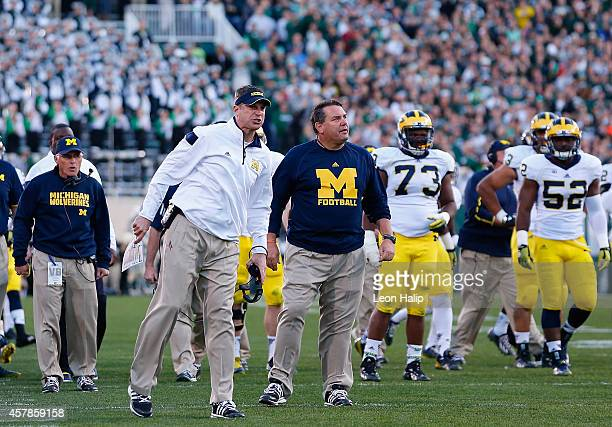 Offensive coordinator Doug Nussmeier and head coach Brady Hoke shout to the officials after a fourth down call during the third quarter of the game...
