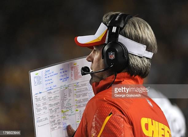 Offensive coordinator Doug Pederson of the Kansas City Chiefs looks on from the sideline during a preseason game against the Pittsburgh Steelers at...