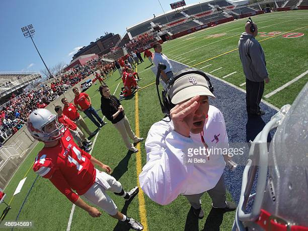 Offensive Coordinator Jeff Behrman of the Stony Brook Offense speaks to Quarterback Conor Bednarski during their Spring Football Game at Kenneth P...