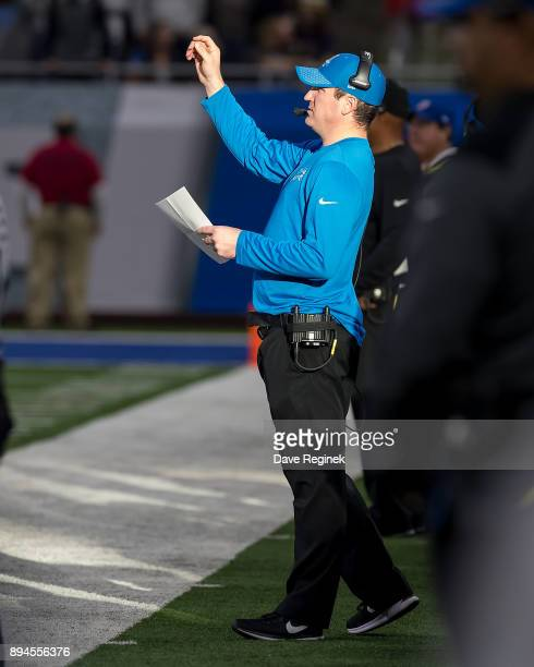 Offensive Coordinator Jim Bob Cooter of the Detroit Lions walks the side lines during an NFL game against the Minnesota Vikings at Ford Field on...