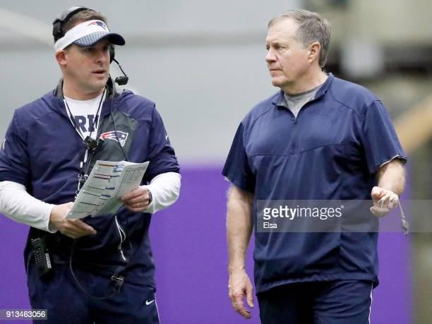 Offensive coordinator Josh McDaniels and head coach Bill Belichick of the New England Patriots talks during the New England Patriots practice on...