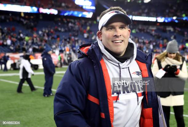 Offensive Coordinator Josh McDaniels of the New England Patriots reacts after winning the AFC Divisional Playoff game against the Tennessee Titans at...