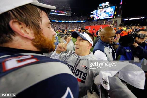 Offensive Coordinator Josh McDaniels of the New England Patriots celebrates after winning the AFC Championship Game against the Jacksonville Jaguars...