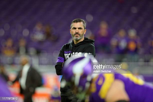Offensive Coordinator Kevin Stefanski watches warm ups before the game against the Washington Redskins at US Bank Stadium on October 24 2019 in...