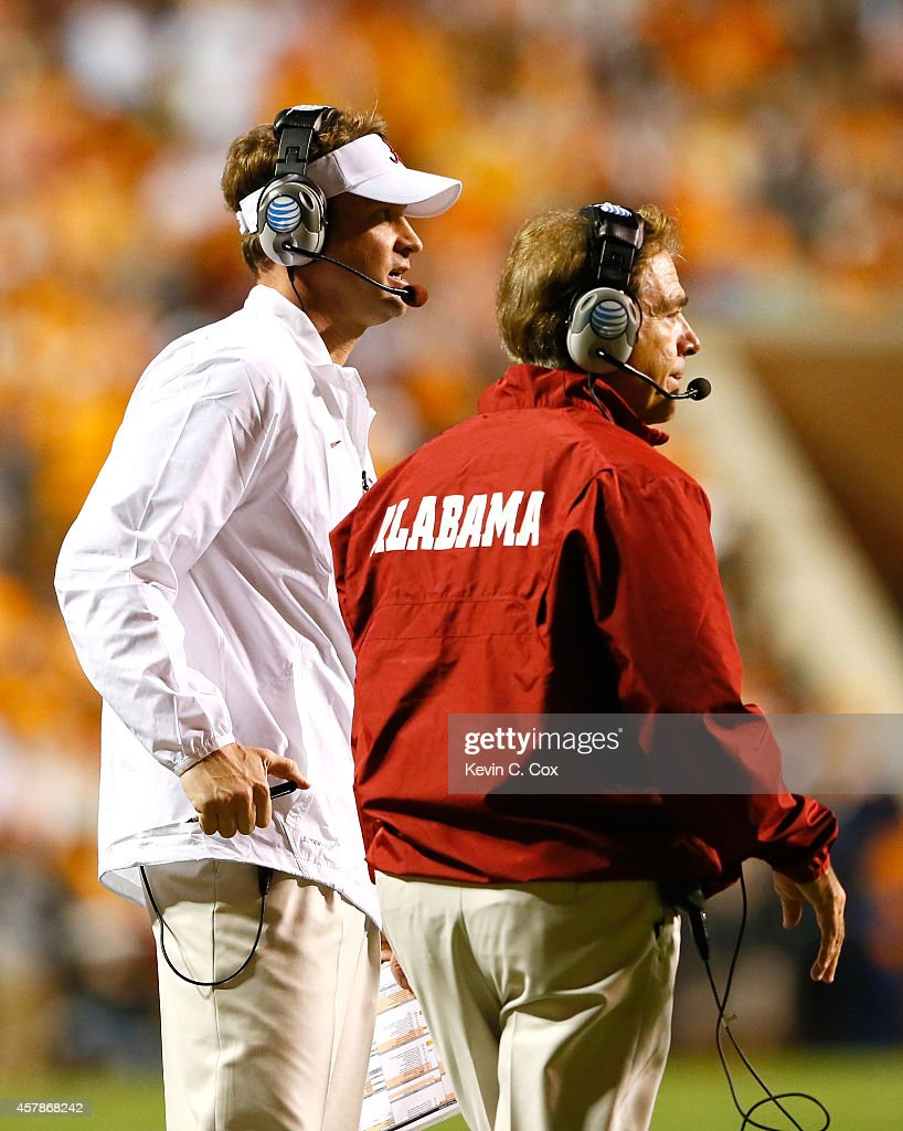 Offensive coordinator Lane Kiffin and head coach Nick Saban of the Alabama Crimson Tide look on during the game against the Tennessee Volunteers at Neyland Stadium on October 25, 2014 in Knoxville, Tennessee.