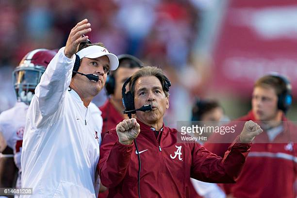 Offensive Coordinator Lane Kiffin and Head Coach Nick Saban of the Alabama Crimson Tide talk on the sidelines during a game against the Arkansas...