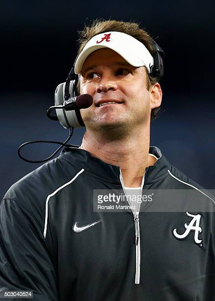 Offensive coordinator Lane Kiffin for the Alabama Crimson Tide looks on during the Goodyear Cotton Bowl against the Michigan State Spartans at ATT...