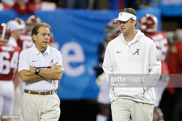 Offensive Coordinator Lane Kiffin of the Alabama Crimson Tide and Head Coach Nick Saben of the Alabama Crimson Tide walk during pre game of the 2016...