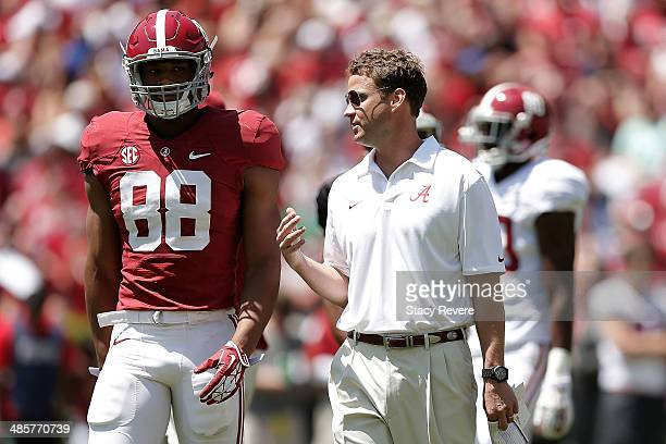 Offensive coordinator Lane Kiffin of the Alabama Crimson Tide speaks with OJ Howard of the Crimson team during the University of Alabama ADay spring...