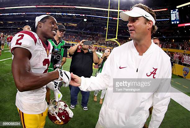 Offensive coordinator Lane Kiffin of the Alabama Crimson Tide talks with Adoree' Jackson of the USC Trojans after the Alabama Crimson Tide beat the...