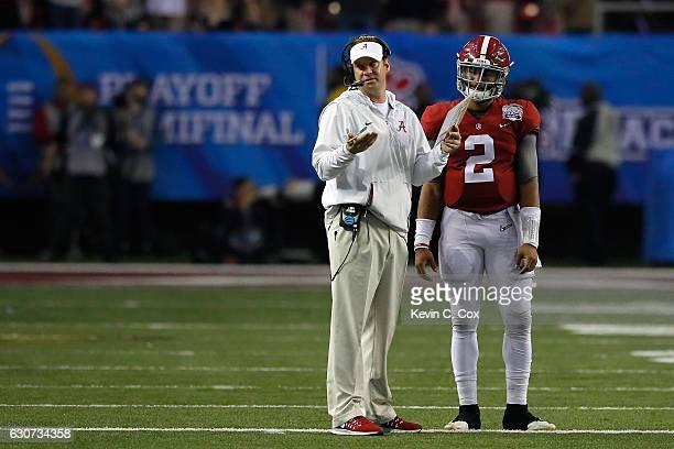 Offensive Coordinator Lane Kiffin of the Alabama Crimson Tide talks to Jalen Hurts of the Alabama Crimson Tide against the Washington Huskies during...