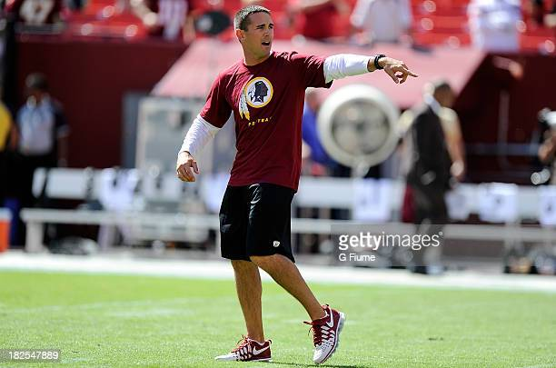 Offensive Coordinator Matt Lafleur of the Washington Redskins watches the teams warm up before the game against the Detroit Lions at FedExField on...