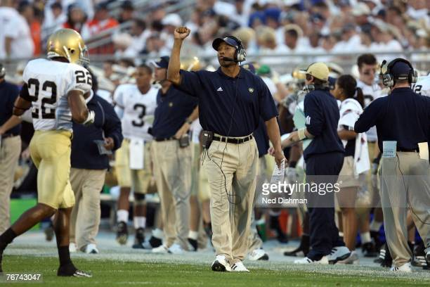 Offensive coordinator Mike Haywood of the University of Notre Dame Fighting Irish calls a play against the Penn State Nittany Lions at Beaver Stadium...