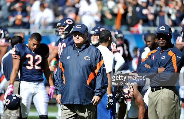 Offensive coordinator Mike Martz stands on the field before the game against the Carolina Panthers at Soldier Field on October 2 2011 in Chicago...