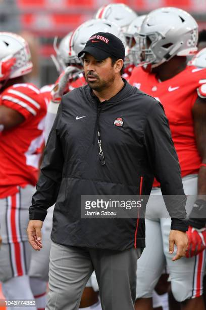 Offensive Coordinator Ryan Day of the Ohio State Buckeyes watches his team warm up before a game against the Tulane Green Wave at Ohio Stadium on...