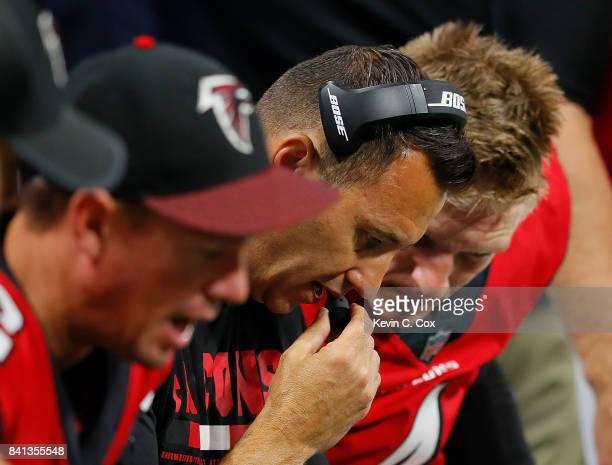 Offensive coordinator Steve Sarkisian converses with Matt Simms and Matt Ryan against the Jacksonville Jaguars at MercedesBenz Stadium on August 31...