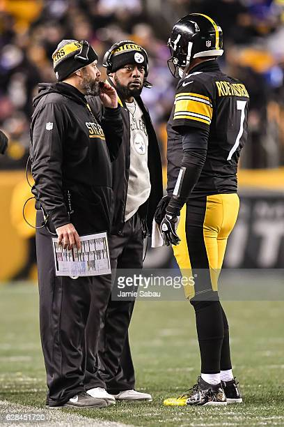 Offensive Coordinator Todd Haley and Head Coach Mike Tomlin both of the Pittsburgh Steelers talk with quarterback Ben Roethlisberger of the...