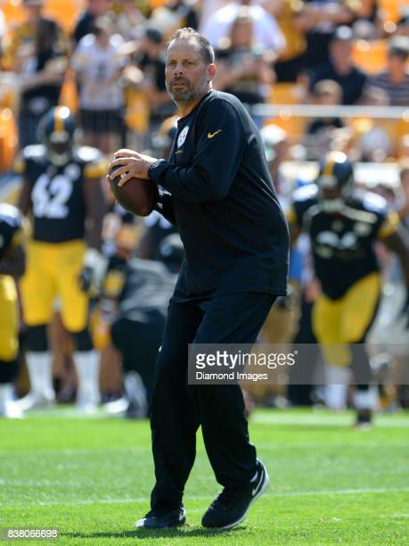 Offensive coordinator Todd Haley of the Pittsburgh Steelers drops back to pass as he aides in warm ups prior to a preseason game on August 20 2017...
