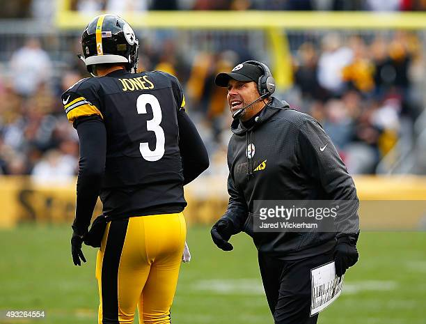 Offensive Coordinator Todd Haley of the Pittsburgh Steelers talks with Landry Jones in the fourth quarter against the Arizona Cardinals during the...