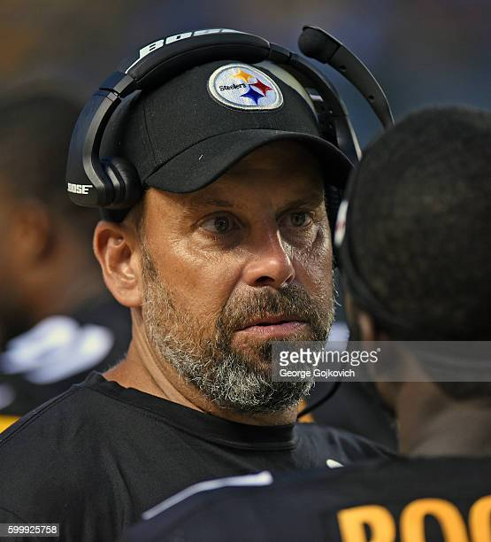 Offensive coordinator Todd Haley of the Pittsburgh Steelers talks to a player on the sideline during a National Football League preseason game...