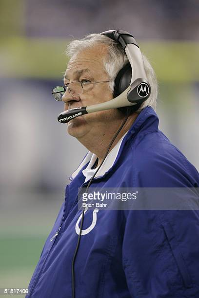 Offensive Coordinator Tom Moore of the Indianapolis Colts watches the game against the Houston Texans on November 14 2004 at the RCA Dome in...