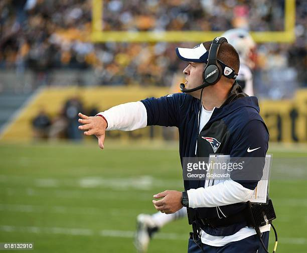 Offensive coordinator/quarterbacks coach Josh McDaniels of the New England Patriots signals during a game against the Pittsburgh Steelers at Heinz...