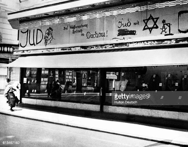 Offensive graffiti on the front of a shop in the Jewish quarter of Vienna in 1938 One of the messages threatens the shop owner with deportation to...