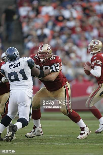 Offensive guard Adam Snyder of the San Francisco 49ers blocks defensive tackle Chuck Darby of the Seattle Seahawks during the NFL game at Monster...