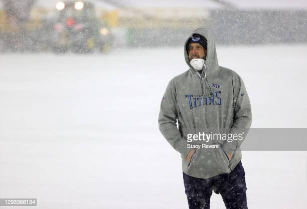 Offensive guard David Quessenberry of the Tennessee Titans walks on the field before warmups against the Green Bay Packers at Lambeau Field on...